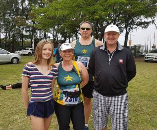 Bronwyn with her proud family and 'coach' Dave